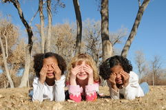 Kids shielding sun from eyes Royalty Free Stock Photography