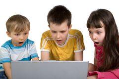 Kids Shocked by Something on Computer Royalty Free Stock Image