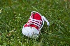 Kids Shoe On Grass Stock Images