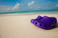 Kids shoes on the beach Royalty Free Stock Image