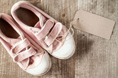 Kids shoes with blank tag Royalty Free Stock Photos