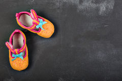 Kids shoes. On dark chalkboard Stock Photo