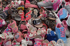 Kids shoes footwear. Kids shoes for sale at street market. Assorted pile of footwear Stock Photo