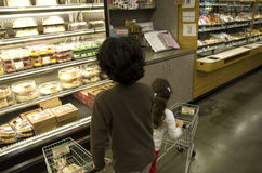 Kids shopping at supermarket Stock Image