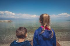 Kids on the shore of Lake Ohrid stock photo