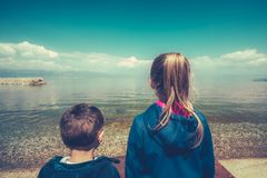 Kids on the shore of Lake Ohrid royalty free stock images