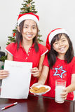 Kids showing blank letter to Santa Stock Images