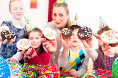 Kids showing muffin cakes at birthday party Stock Image