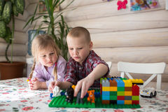 Kids siblings brother and sister playing constructor, casual lif Stock Photo