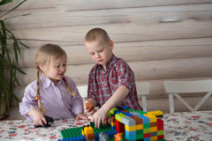 Kids siblings brother and sister playing constructor, casual lif Stock Images