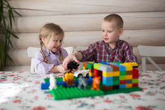 Kids siblings brother and sister playing constructor, casual lif Royalty Free Stock Image