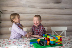 Kids siblings brother and sister playing constructor, share toys Royalty Free Stock Photos