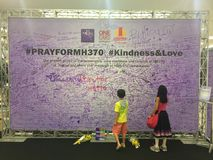 Kids sign billboard to pray for missing MH370 Stock Photos