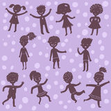 Kids silhoeuttes. Funny cartoon kids silhoeuttes on violet background Royalty Free Stock Photos