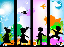 Kids silhouettes. At play; nature Royalty Free Stock Photos
