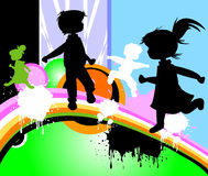 Kids silhouettes. Running and jumping Royalty Free Stock Photo