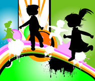 Kids silhouettes. Running and jumping Stock Photos