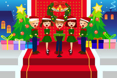 Kids singing Christmas Carols Royalty Free Stock Photo