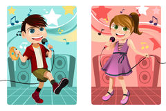 Kids singing karaoke Stock Image