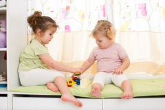Kids sisters play together Stock Photography