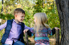 Kids Sitting on the Fence Holding on the Brace Royalty Free Stock Image