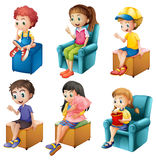 Kids sitting. Illustration of the kids sitting on a white background Royalty Free Stock Image