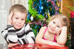 Kids sitting near gifts Royalty Free Stock Photos