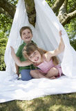 Kids Sitting In Sheet Tent In Backyard Royalty Free Stock Images