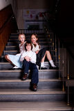 Kids sitting on the stairs Royalty Free Stock Image