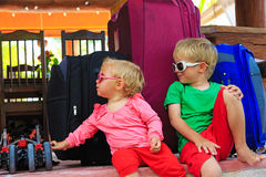 Kids sitting on suitcases ready to travel Royalty Free Stock Photo