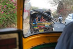 Kids sitting in Tuk-tuk on a evening in Jaipur, India royalty free stock photo