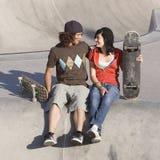 Kids at skatepark. Teen couple hang out at skatepark Stock Photos