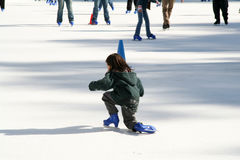 Kids Skating. Kid getting up from Ice Skating stock image