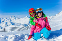 Kids at ski resort. Kids enjoying winter vacation at ski resort Royalty Free Stock Images