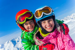 Kids at ski resort. Kids enjoying winter vacation at ski resort Royalty Free Stock Image