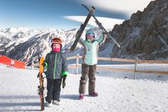 Kids in ski school at mountains. Children learn downhill skiing. stock photography