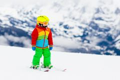 Kids ski. Winter family snow sport. Child skiing stock images