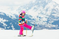 Kids ski. Winter family snow sport. Child skiing. Child skiing in the mountains. Kid in ski school. Winter sport for kids. Family Christmas vacation in the Alps royalty free stock image