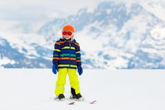 Kids ski. Winter family snow sport. Child skiing stock photos