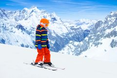 Kids ski. Winter family snow sport. Child skiing stock images