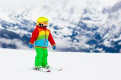 Kids ski. Winter family snow sport. Child skiing. Child skiing in the mountains. Kid in ski school. Winter sport for kids. Family Christmas vacation in the Alps royalty free stock photos