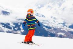 Kids ski. Winter family snow sport. Child skiing royalty free stock image