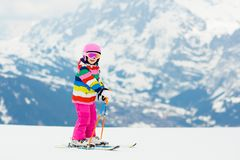 Kids ski. Winter family snow sport. Child skiing stock photography