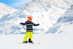 Kids ski. Winter family snow sport. Child skiing. Child skiing in the mountains. Kid in ski school. Winter sport for kids. Family Christmas vacation in the Alps royalty free stock photography