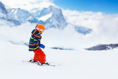 Kids ski. Winter family snow sport. Child skiing royalty free stock images