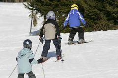Kids skiing. Young kids are practicing skiing Stock Photo