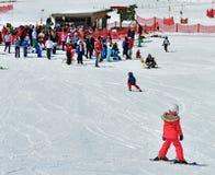 Kids skiing in an Austria ski school Stock Photos