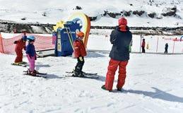 Kids skiing in an Austria ski school Stock Images