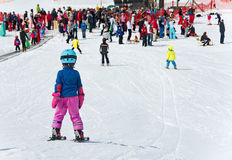 Kids skiing in an Austria ski school Royalty Free Stock Photo