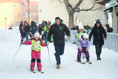 Kids skiing in city center Stock Photography